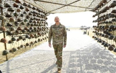Wave of anger over Aliyev poses in front of dead Armenian soldiers' helmets – Photos & VIDEO